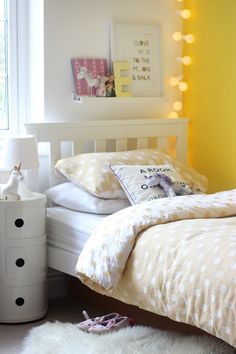 Add a splash of colour to kids bedrooms with a statement wall and bedding to compliment.