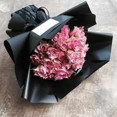 Daring enough to use black paper?  Regardless of color, love the way the flowers are wrapped.