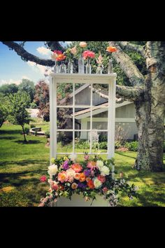 Window box/seating chart. Peonies, roses and astilbes.  By: Azalea Floral Design in Plainville CT