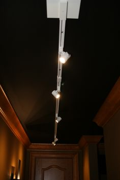 DH Custom Homes, home theater in Chesterfield, MO. Track lighting along the ceiling.