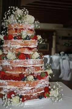 tiered victoria sponge with fresh fruit and flowers
