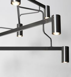 Pieces of pipes fitted for connected by rectangular tubes. Every arm is connected by a joint piece. The chandelier has wire suspension. Pipe Fitter, Wall Lights, Chandelier, Autumn, Lighting, News, Home Decor, Appliques, Candelabra