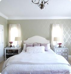colors. light grey walls, cream headboard, white and purple bedding, splash of black or white furniture.