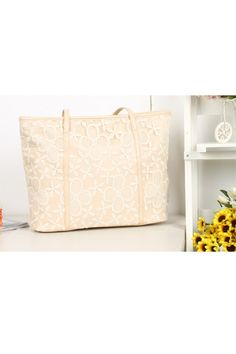 This handbag crafted in PU, featuring embroidery panel design, top zip closure, double slim handles.$57