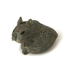 "Incense Burner Lid in the Shape of a Feline - LO.1051 Origin: Central Asia Circa: 12th th Century AD to 13th th Century AD  Dimensions: 2.5"" (6.4cm) high  Collection: Islamic Art Medium: Copper-Alloy   Additional Information: AS £8,600.00  Location: Great Britain"