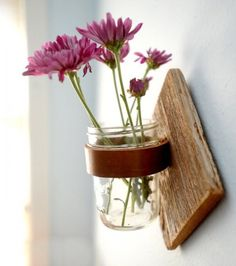 Mason jar sconce, with a leather strap instead of a metal ring.