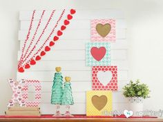 Colorful frames—adorned with burlap and bright scrapbook paper—create a cheerful way to show off family photos for Valentine's Day.  Get the tutorial at Crafts by Courtney.   - CountryLiving.com