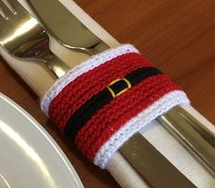 This is a crochet pattern for a Christmas Santa napkin ring. (It is not a…