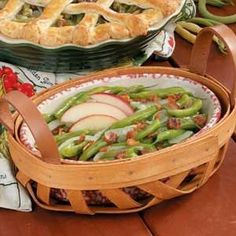 Green Beans German Style Recipe -My mother-in-law introduced me to this quick down-home dish almost 50 years ago when I was a new bride. The tender green beans are topped with diced bacon and a classic sweet-sour glaze. Guests always ask for the recipe. -Vivian Steers, Central Islip, New York