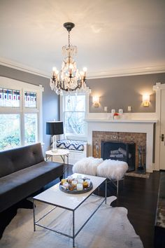 coco & kelly - living rooms - chic living rooms, living room chandelier, gray settee, gray tufted settee, dark grey settee, white cowhide ru...