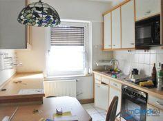 Die Küche bildet den Mittelpunkt der gemütlichen Wohnung.
