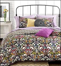 abstract. Traditional mosaic designs get a makeover in these Mosaic Damask duvet cover sets. Bold colors and flowing designs fuse together to create a new take on modern while plush decorative pillows complete this eye-opening look.