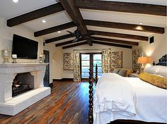 Spanish Colonial Revival nestled between Mummy & C'back Mtns. - love this wood floor....