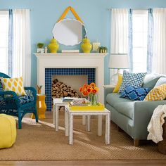 Sun in the Sky.  Was there ever a cuter color combination than blue and yellow? This bright, cheerful room suggests no. Varying shades of each color work in tandem to create a youthful, family-friendly gathering place. A blue sofa, chair and walls create a perfect backdrop for yellow accessories to shine, just like the sun in the sky. The blue tile on the fireplace surround is the perfect pop of color to polish off the look.