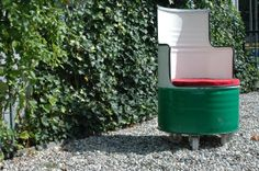 A chair made from an old barrel of Castrol, inside is an old tire and a plywood panel.