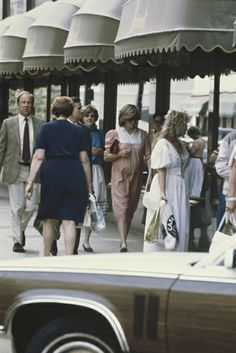 Princess Diana shopping at Harrods in London - 1982 baby count down. Anne Beckwith Smith is behind her.