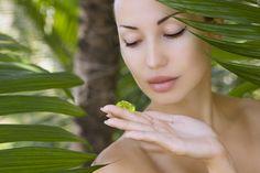Beautiful Woman Holding Aloe Vera Gel, Skin Care And Wellness. F