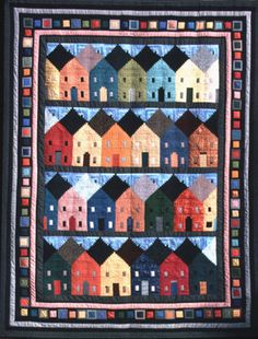 This is so cool. Artist Flavin Glover's design is a Log Cabin house and begins with a basic traditional square block or a multi-width log rectangular Courthouse Steps block. There's a tutorial and a pattern at http://www.flavinglover.com/around_corner_pattern/around_corner_instructions_2.htm.