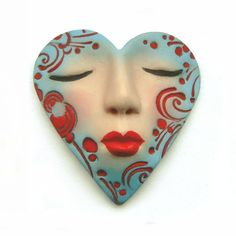 Turquoise Blue Red Heart Valentines Day Dream Art Doll Goddess Face Cab Sleepy polymer clay cabochon 2420. $9.25, via Etsy.