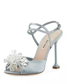 """Forma Crystal-Embellished Sandal, Blue.  Miu Miu satin sandal with crystal-embellished sunburst brooch at vamp and a 4.3"""" covered pedestal heel. Tapered strap bands open toe, strappy vamp and adjustable ankle strap with a padded footbed."""