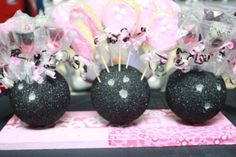 Cool bowling ball center pieces. Styrofoam balls painted black! Awesome