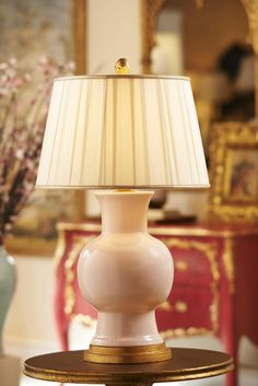 Juliette Lamp in rose with a pleated shade.