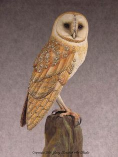 Owl Sculpture by Jerry Simchuk. Tupelo wood and acrylic paint.