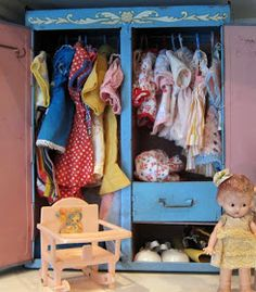 A wardrobe full of vintage doll clothes!