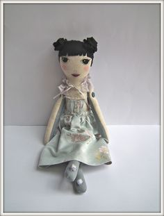 cloth doll with such a cute face and hair.