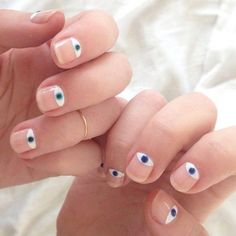 What would nails look with eyes? This is what you'll get. Coated with clear polish as base, white polish is then painted in the inner edge of the nails covering the cuticle. On…