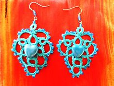 Heart shaped earrings made with tatting technique.