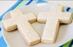 Cross shaped sugar cookies. Quilt design with edible pearls on fondant.