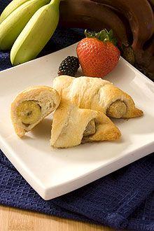 Mini bananas baked in croissant dough wraps make easy banana appetizers.