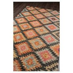 The Varden rug features tribal inspired a repeating geometric motif in varying shades of black, rusty red, beige, orange, blue, beige and light pink to create a design that is visually pleasing. This rug is washed using a special process to create a rich, well loved look and appeal from the very first day you place it in your room. The tip shearing creates a combination of cut and loop pile for added texture and dimension. Densely woven of 100% wool for lasting beauty and durability.