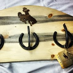 Wyoming bucking horse coat rack made from salvaged beetle wood #bluepine #madeinwyoming
