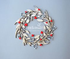 A beautiful wooden Christmas wreath. With red berries. It is a amazing decoration for your home and office. It may be a perfect gift for a Christmas, birthday, housewarming, Valentine's day , Wedding, Thanksgiving day, Anniversary. __________________________________________________________ Size: 30 cm x 30 cm (12 inches x12 inches) with a thickness of 6-10 mm It was draw by myself .Laser cut from birch plywood. Wreath is handpainted on one side only, it easy to hang on to small nail. The…