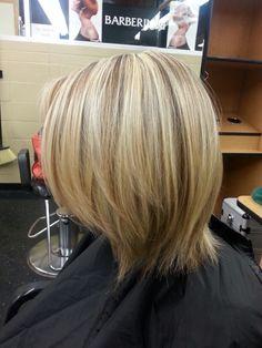 Beautiful Blonde weaved highlights.
