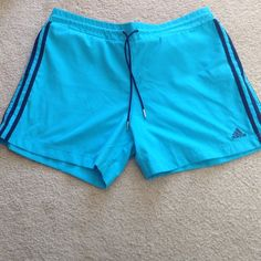 Adidas shorts (blue) Blue Adidas shorts, navy blue stripes on the side. Draw string waist. Worn a hand full of times. No visible signs of wear. Adidas Shorts