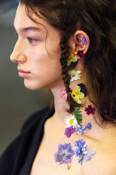 At Preen by Thornton Bregazzi, Garland dreamed of Woodstock and glued real flowers onto the skin.