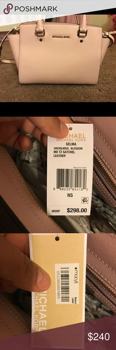 Micheal Kors pink bag Brand New bag I never used it is a pretty pink blush and it still has tags even the return labs from Macy's you can carry it over shoulder cris cros or just normal Michael Kors Bags