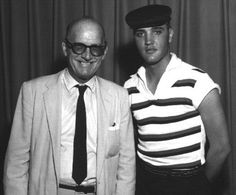 Waco,TX, ca. July 1958: Elvis is posing with Waco Theater owner Claude Stewart. He is wearing a striped shirt lent to him by his friend from Waco, Eddie Fadal.