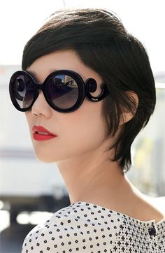 adorable glasses.  red lips and a sunny day.
