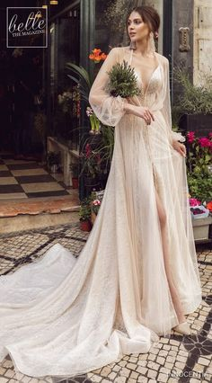 Innocentia Divina Wedding Dresses 2019 – Belle The Magazine Innocentia Divina Wedding Dresses 2019 Lisboa Bridal Collection. A-line ivory wedding dress with long sleeves cape and long train high slit deep v-neckline Gorgeous Wedding Dress, Perfect Wedding, Beautiful Dresses, Bridal Dresses, Wedding Gowns, Bridesmaid Dresses, Ivory Wedding, Wedding Dresses With Slit, Wedding Dress Cape