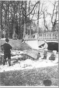 Nicholas clearing ice - Guards in background - Tsarskoe Selo - 1917.