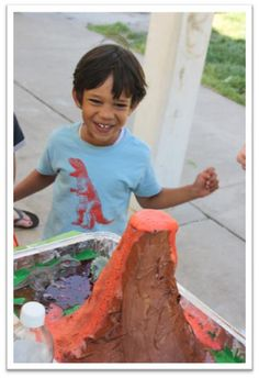 I wonder if i can make one of these in the back yard to use a lg decoration/activity... Dino party volcano. Baking soda + vinegar + food coloring