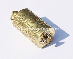 Tibetan Prayer Wheel Pendant with Mantra by TibetanBeadStore, $6.00