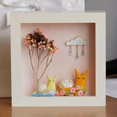 I just love these dioramas. Oh, I love the snails too. The pretty colors on the tree are actually clay too.
