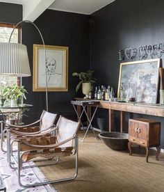 Modern and Masculine Living Room with Charcoal Gray Walls, and Leather Slingback Chrome Chairs.