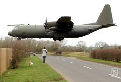 C-130 Hercules low above the road. Brize Norton, England.