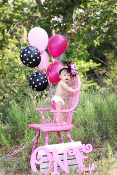 Get gender neutral (green, yellow, white?) letters to use at first birthday shoots. Find a chair to paint in matching color. Compliment with balloons to match theme and letters.